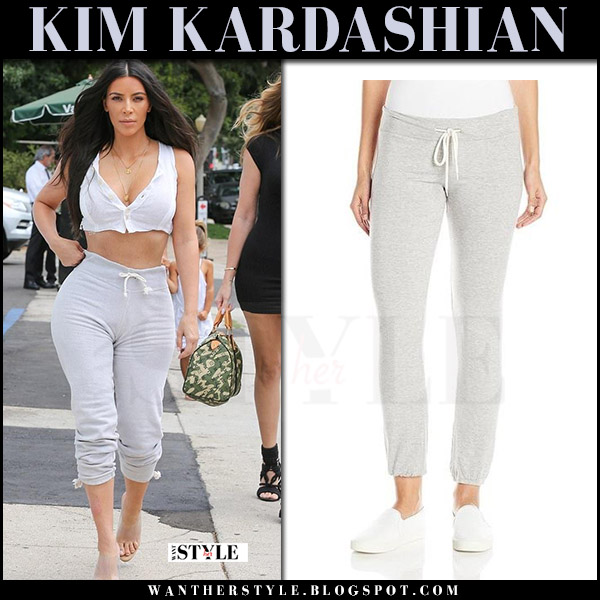 Kim Kardashian in grey sweatpants monrow and transparent mules yeezy what she wore july 25 2017 streetstyle
