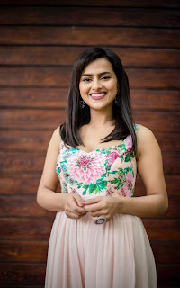 Sraddha Srinath Stunning Pics in flower print sleeveless gown