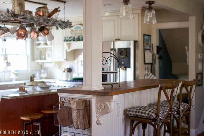 Farmhouse style x back barstools in kitchen with Christmas decor - Golden Boys and Me Holiday Home Tour 2017