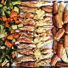 Baked Cheesy Augustine Tiger Prawns with roasted vegetables and sausages