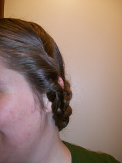 Side braid with roll above.