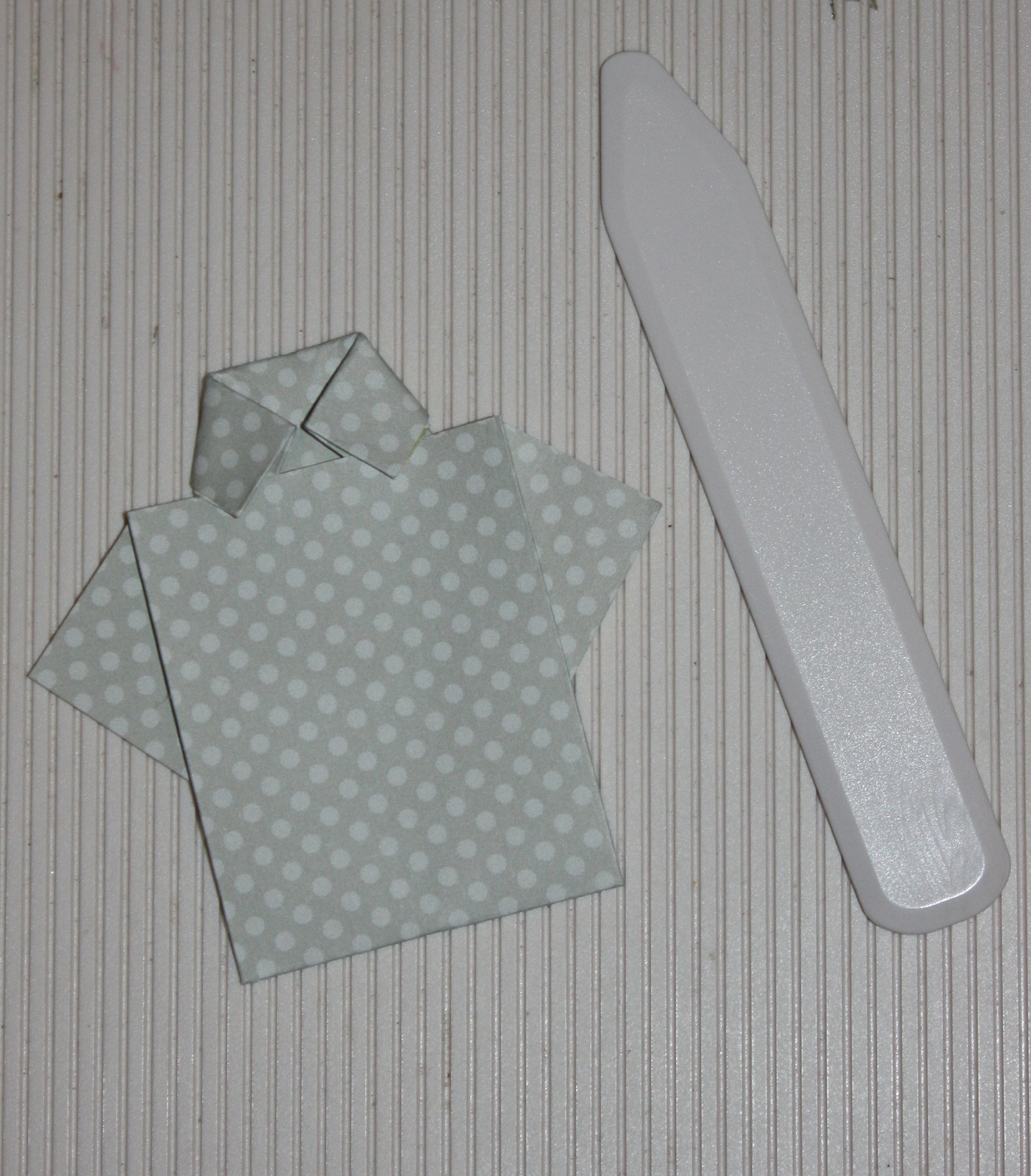 Papers Pads and Pictures: A Paper Folded Man's Shirt