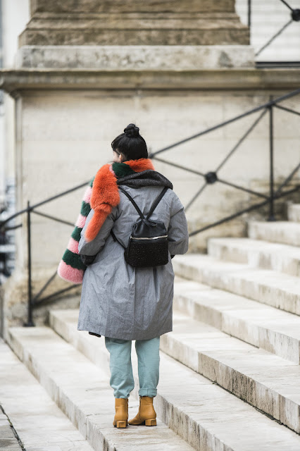 large coat small backpack