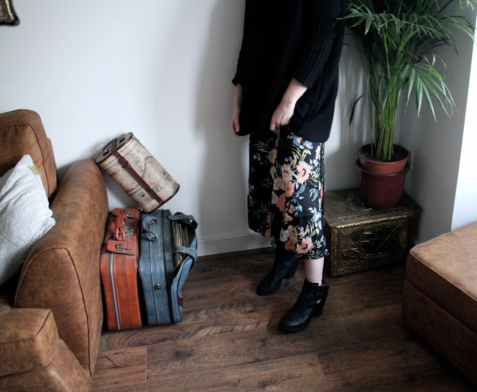 Vintage style room and crop of girl wearing floral maxi dress and black jumper