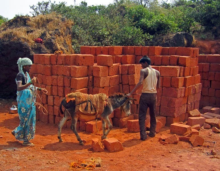 workers loading bricks
