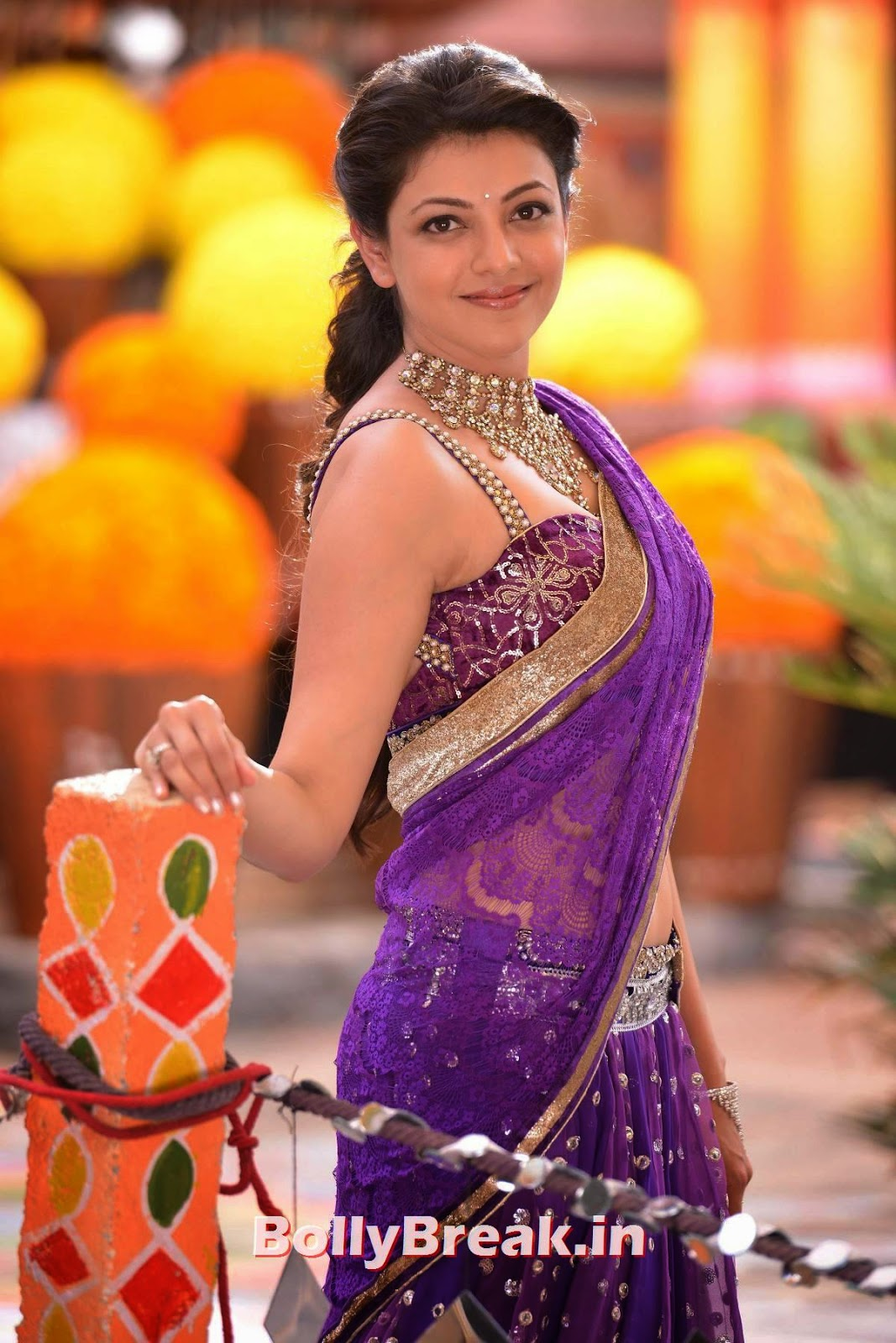 In purple sleeveless blouse saree kajal aggarwal in tight dress