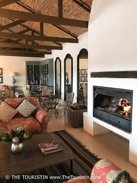 Country style interior design at the Fig Tree Restaurant lounge area, with an open fireplace at the De Hoop Nature Reserve.