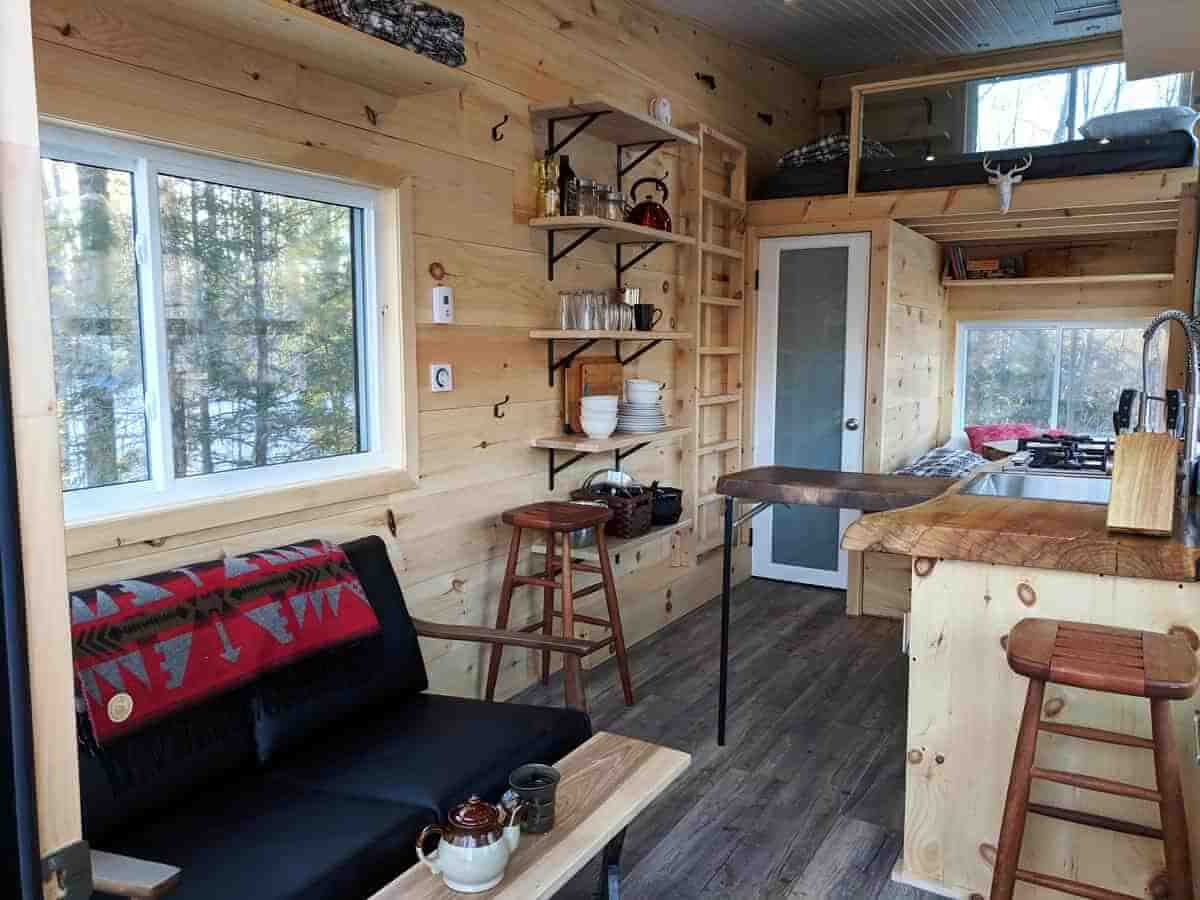 06-Sitting-Room-and-Dining-Room-Cabinscape-Off-Grid-Cabin-Tiny-Home-Architecture-www-designstack-co