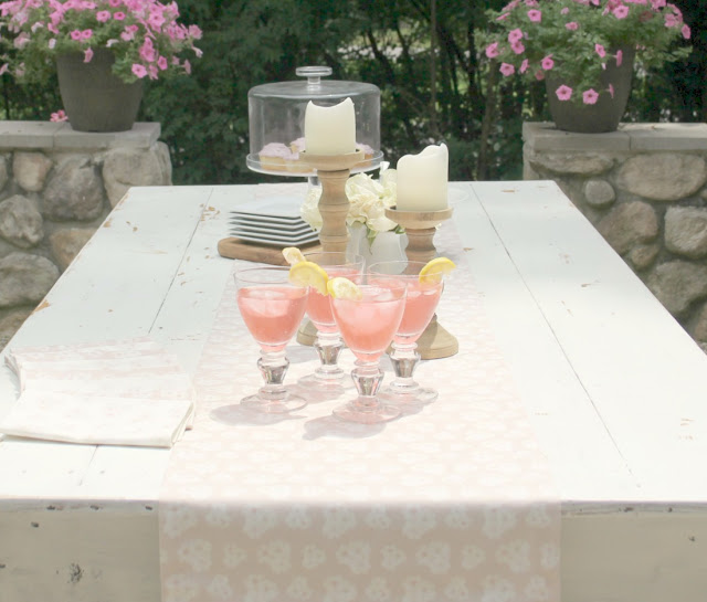 White farm table with blush pink table runner - Hello Lovely Studio