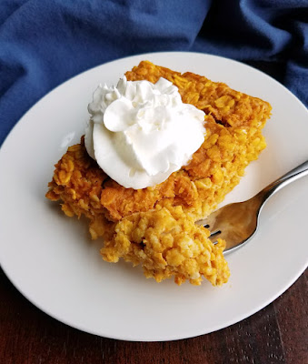 square piece of pumpkin baked oatmeal on plate with fork