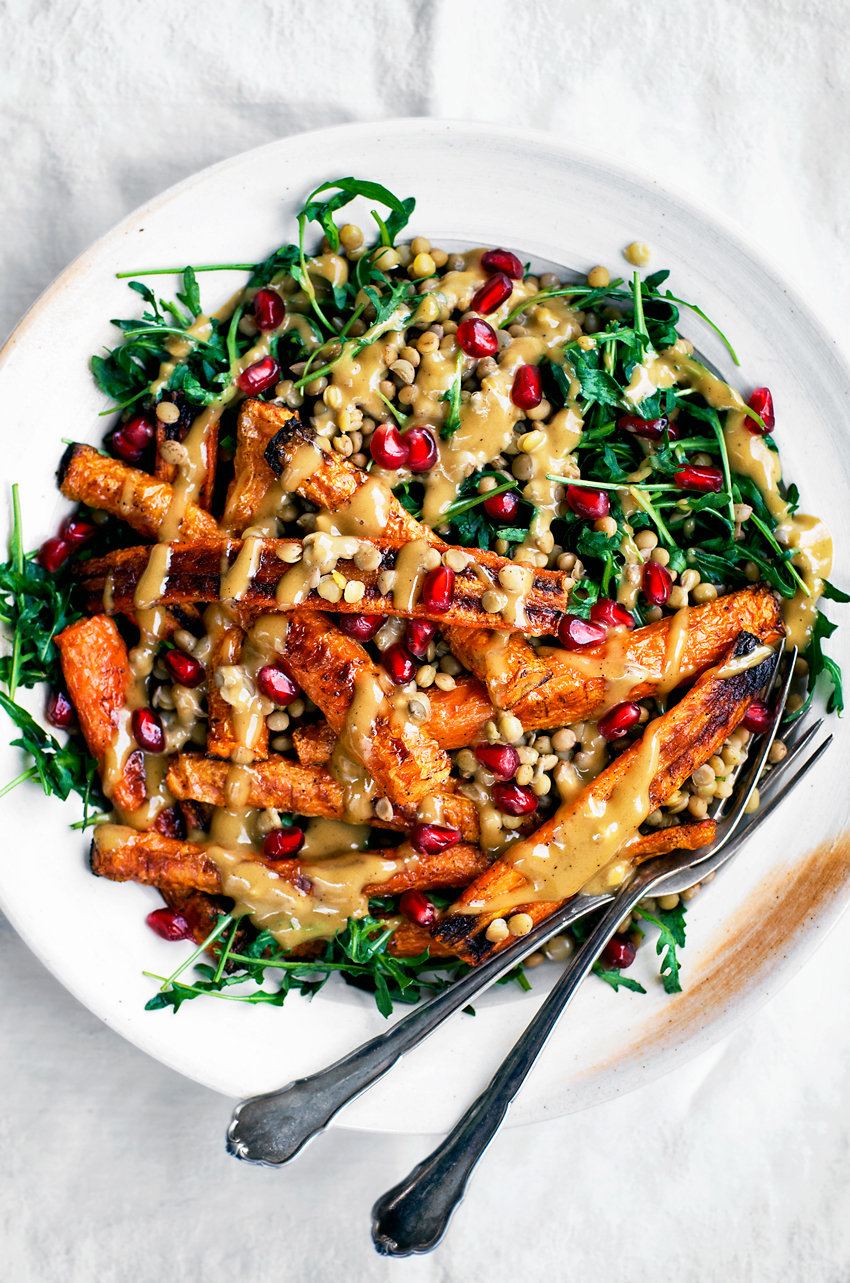 Lentils are topped here with roasted carrots, a creamy dairy free tahini dressing, and rucola for a cozy, filling warm vegan salad. This is an easy weeknight meal, packed with nutrition, and delicious year round.