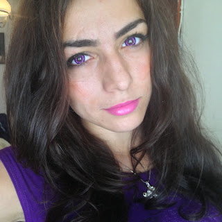 Person wearing purple lenses