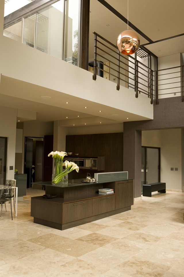 Picture of large open and modern kitchen with dark brown furniture