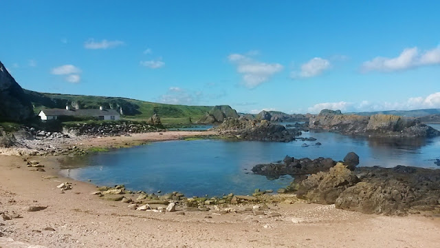Ballintoy Harbour coastline and building