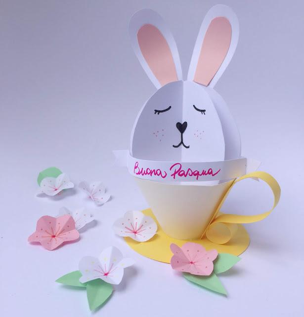 decora la pasqua con un coniglio di carta in una tazza