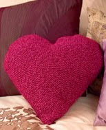 http://www.letsknit.co.uk/free-knitting-patterns/heart_cushion