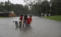 A family evacuate their home after flooding from Hurricane Harvey, Houston, Texas, 27 August. (Photograph Credit: Joe Raedle/Getty Images) Click to Enlarge.