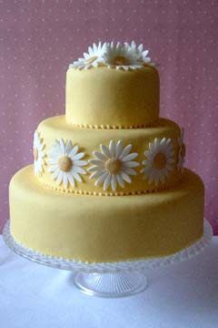 yellow daisy wedding cake