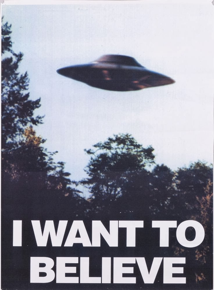 Poster hanging in Mulder s office X Files Wallpaper I Want To Believe