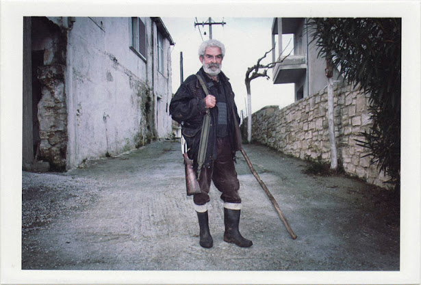 dirty photos - time - cretan landscape photo of cretan old man gith gun