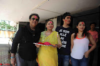 Govinda celeting Holi with His family wife daughter 018.JPG