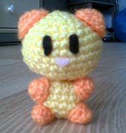 http://www.ravelry.com/patterns/library/bear-cat-amigurumi