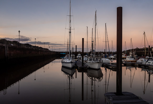 Photo of reflections in the calm water at Maryport Marina on Sunday
