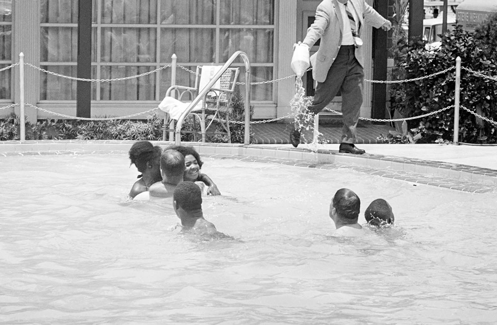 When a group of white and African American integrationists entered a segregated hotel swimming pool, manager James Brock poured acid into it, shouting