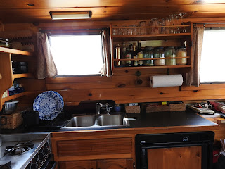 Kitchen on solar canal boat dragonfly