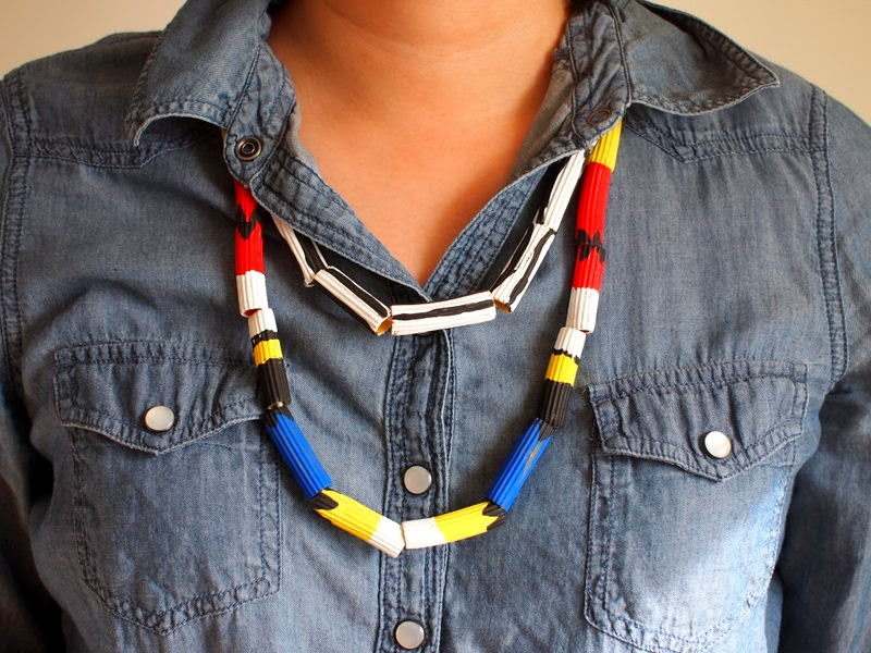 painting pasta necklaces with kids