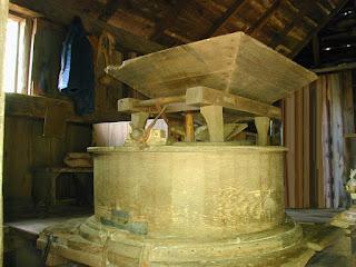 The actual milling equipment, corn hopper, mill grinding stone, flour box.
