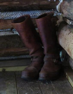 Bob Webber's boots displayed in Webber Cabin