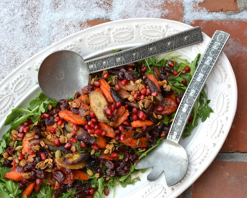 Celebration Salad (Maple-Roasted Carrots with Arugula, Dill, Cranberry Vinaigrette, Pomegranate and Glazed Pecans), an exultant platter of vegan texture, color, flavor and mood ♥ KitchenParade.com