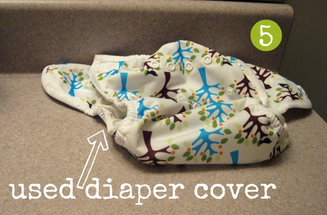 used cloth diaper cover airing out on bathroom counter
