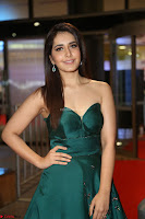 Raashi Khanna in Dark Green Sleeveless Strapless Deep neck Gown at 64th Jio Filmfare Awards South ~  Exclusive 122.JPG