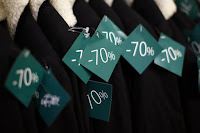 Discount sale tags are seen on clothes at a department store in Paris on the first day of the winter sales in France, January 6, 2016. (Credit: Reuters/Benoit Tessier/File Photo) Click to Enlarge.