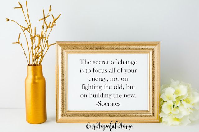 Socrates quote about change in gold frame.