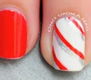 http://onceuponnails.blogspot.com/2014/12/candy-canes-and-snowflakes.html