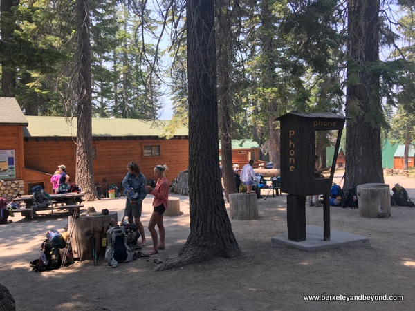 people relaxing at Reds Meadow shuttle stop at Devils Postpile National Monument in Mammoth Lakes, California
