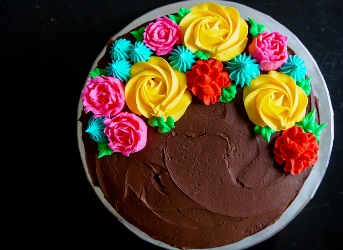 Cinco de Mayo Cake with bright buttercream flowers and a colorful border