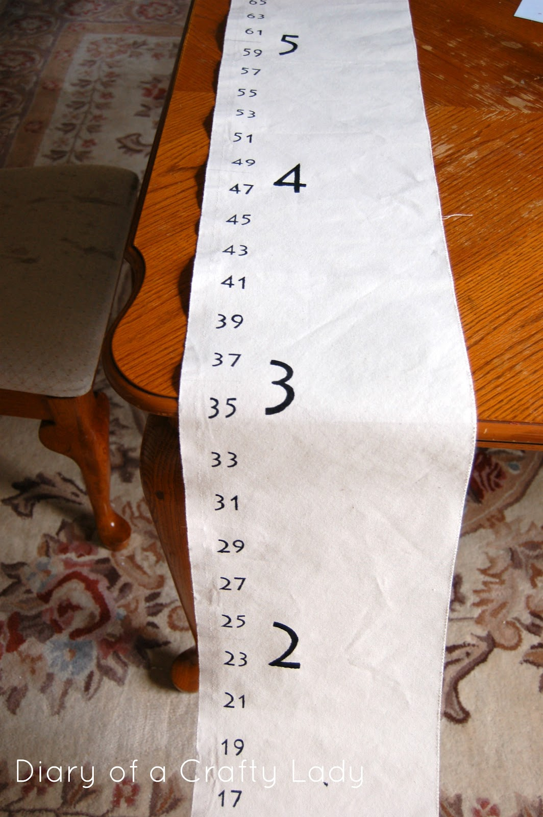 Diary of a crafty lady diy canvas growth chart the lines see below were made with a ruler and a paintbrush that i ran along the edge of the ruler the odd numbers had 5 long lines the even number geenschuldenfo Images
