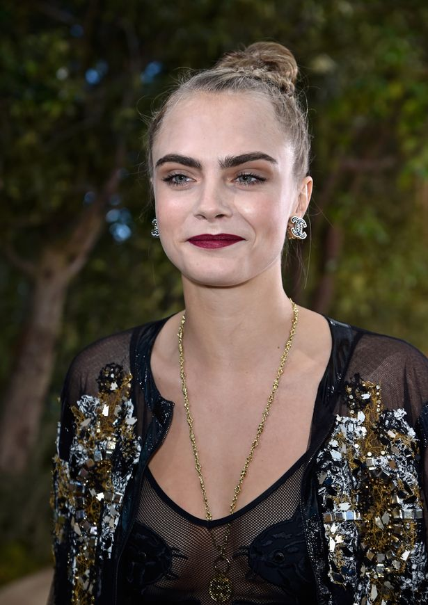 Cara Delevingne supports BFF Kendall at Chanel fashion show