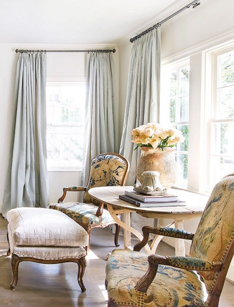 Elegant antique arm chairs in sitting area by Eleanor Cummings