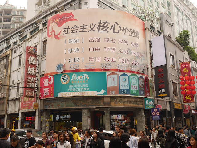 "sign with China's 12 ""core socialist values"" in Guangzhou"