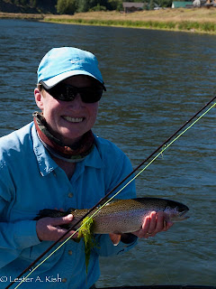 Happy angler with a Missouri River, Montana rainbow trout