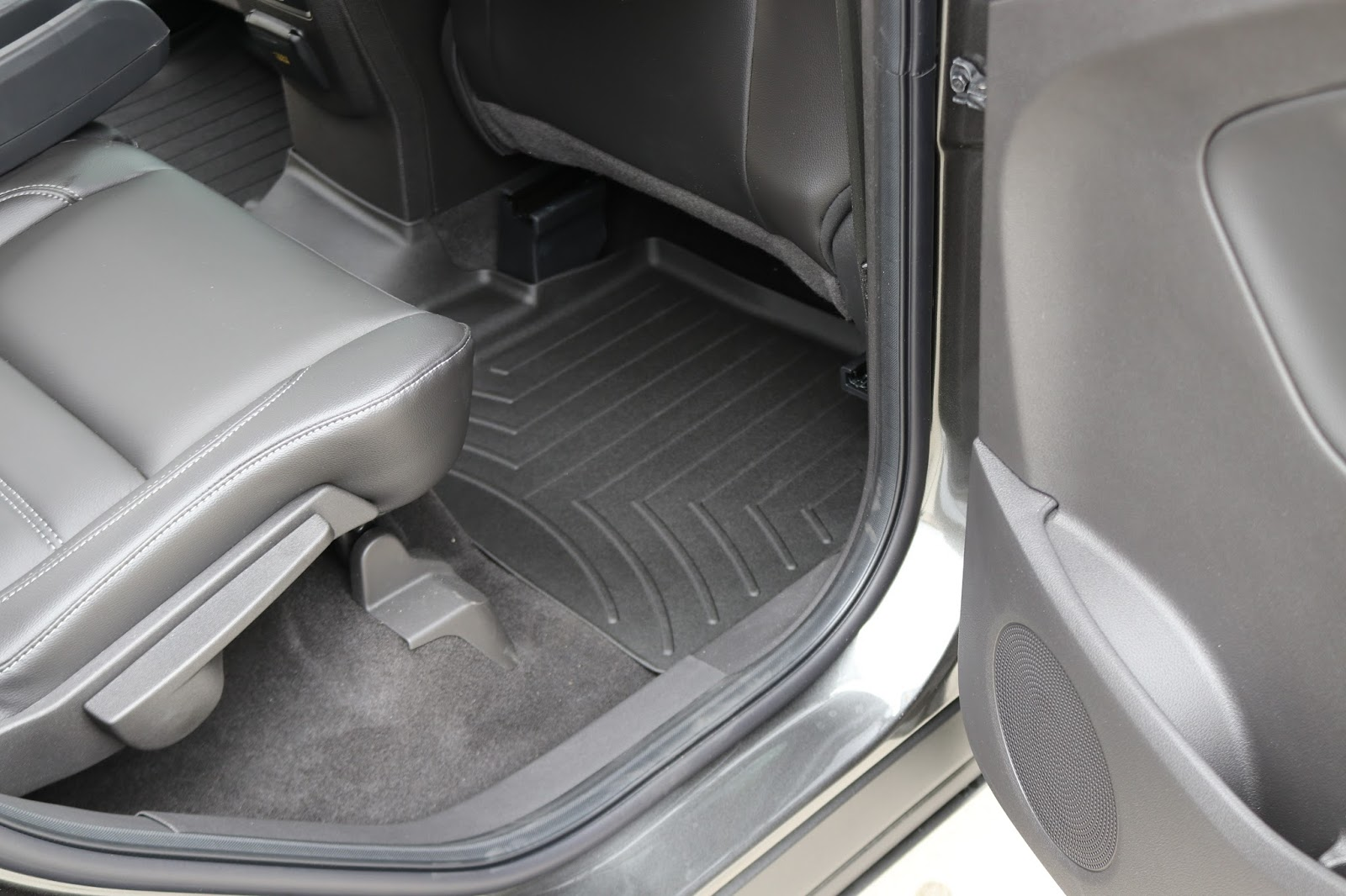To protect the rear floor carpet from messy kids and employees we selected a custom fit weathertech digital fit floor liner these molded liners have a