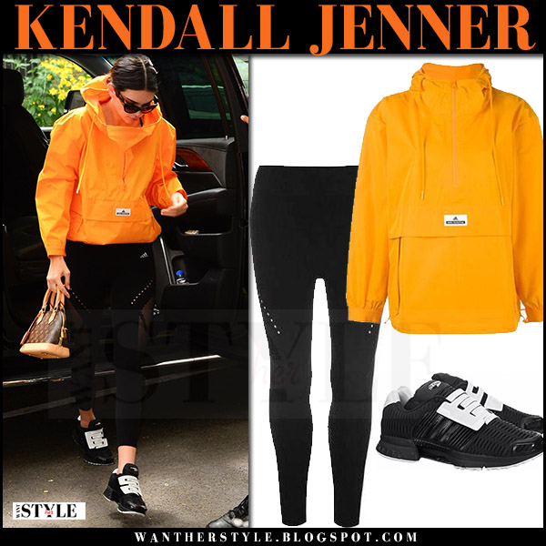 Kendall Jenner in orange jacket and black leggings adidas gym clothes july 27 2017 what she wore