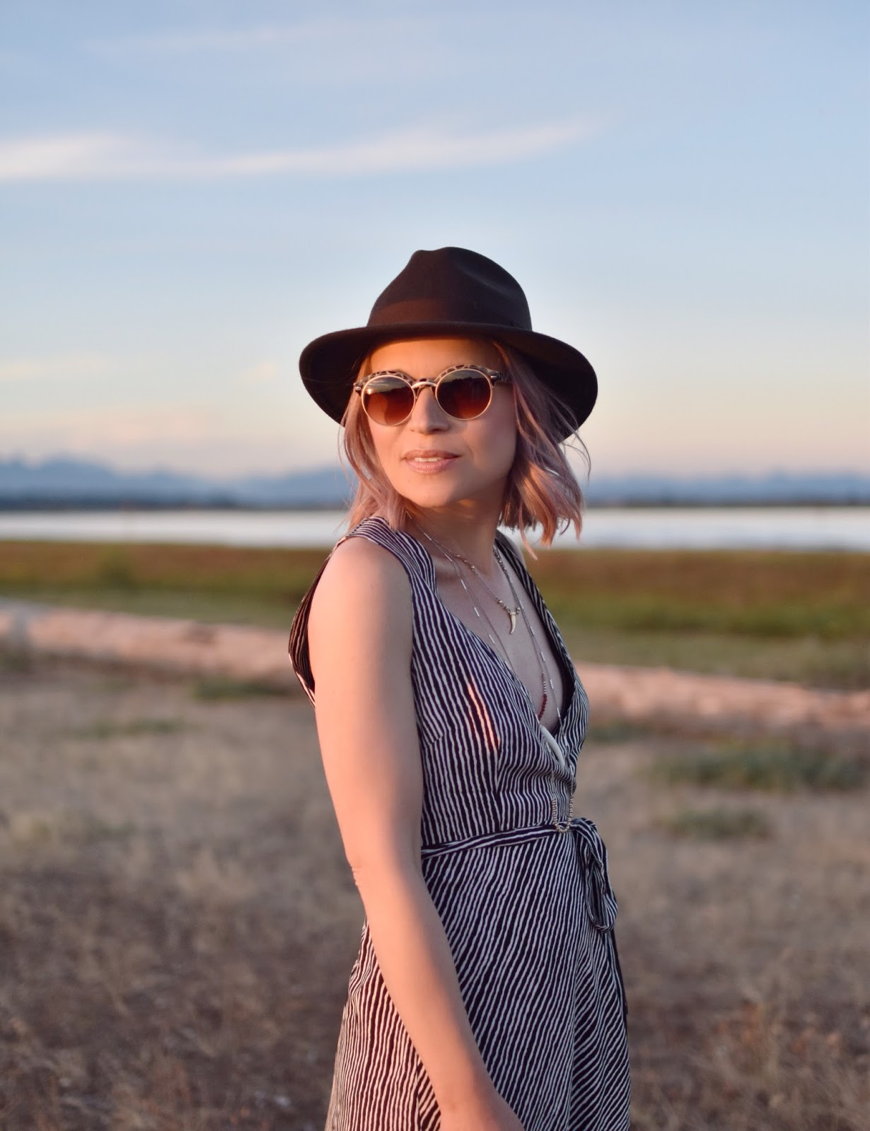 Monika Faulkner personal style inspiration - black and white striped maxi-dress, brown felt fedora, animal-patterned sunglasses