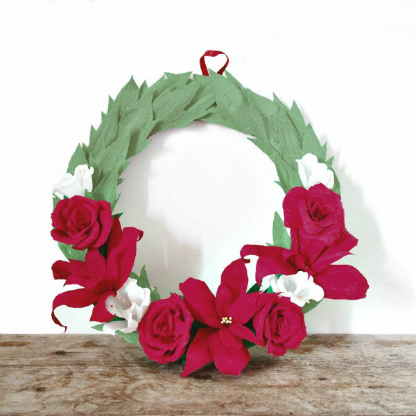 Crepe Paper Holiday Wreath with rosy pink paper roses, paper poinsettias, and white paper snowdrops