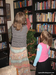 assistance from small friends in decorating our Christmas tree, in our annual custom